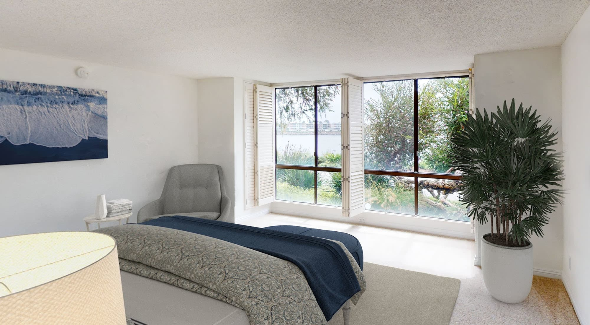 Bay windows and plenty of natural light in a model home's bedroom at Primary bedroom with large bay windows and a walk-in closet in a model home at Mariners Village in Marina del Rey, California