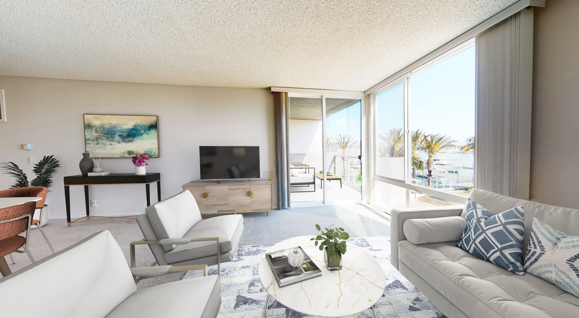 Living room with floor-to-ceiling windows and view of the marina at Waters Edge at Marina Harbor in Marina del Rey, California