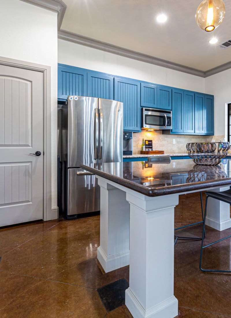 Community clubhouse kitchen at   Marquis Grand Lakes in Richmond, Texas