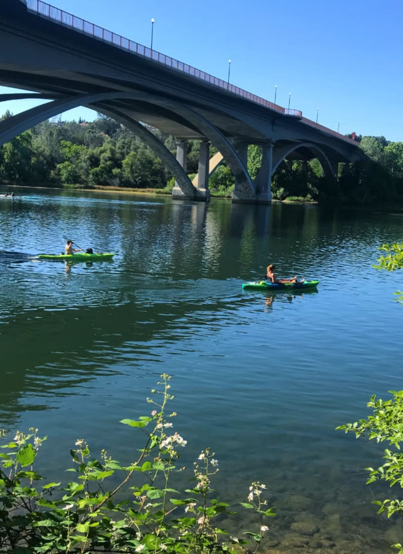 Residents kayaking near The Fairmont at Willow Creek in Folsom, California