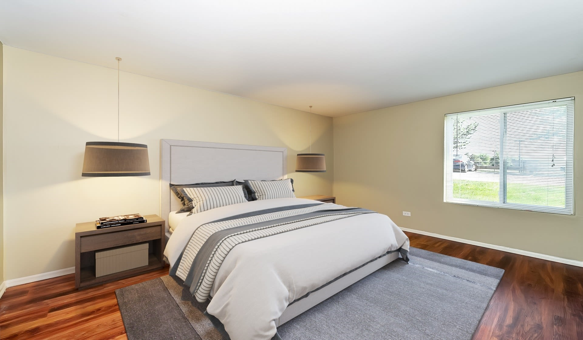 Large master bedroom with a window for natural lighting at Lakeside Apartments in Lisle, Illinois