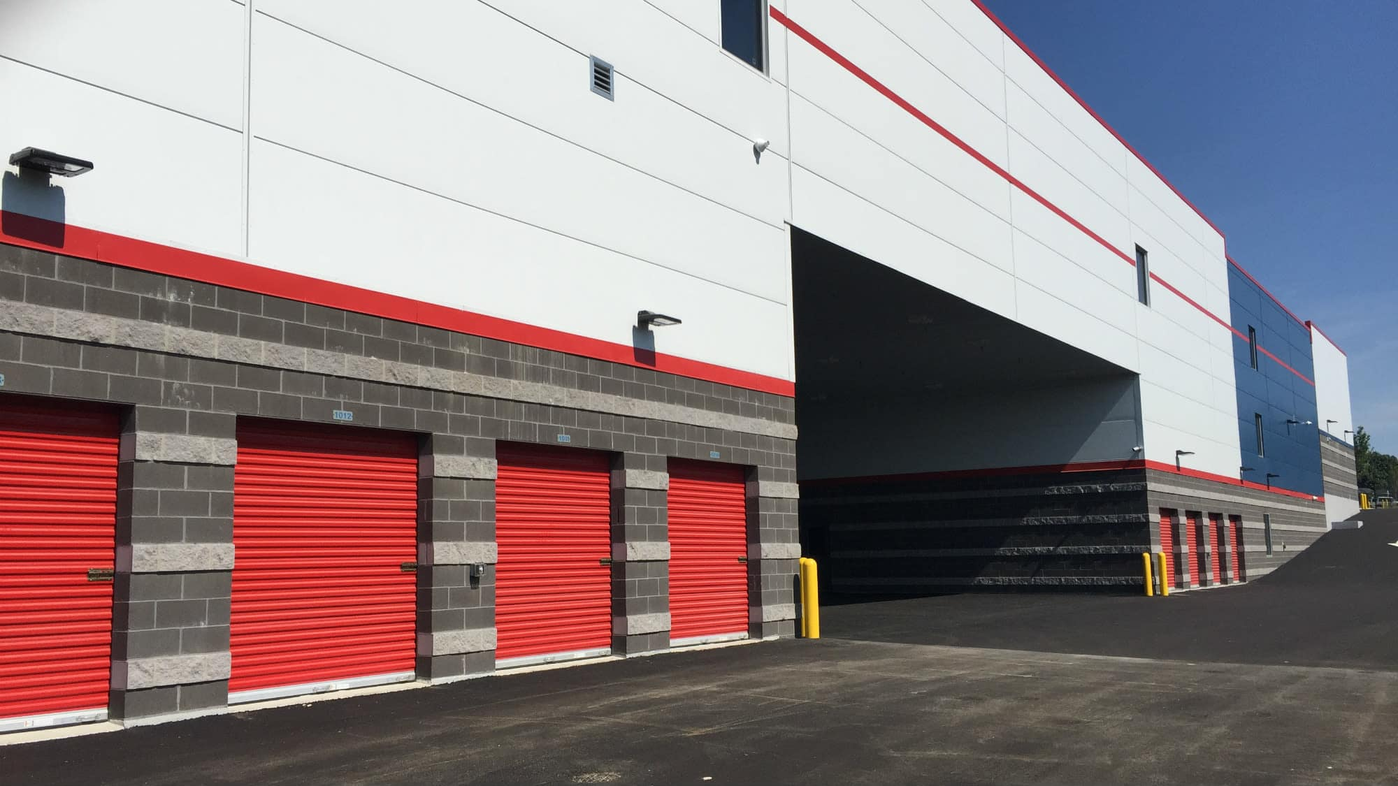 Red drive-up units at Self Storage Plus in Owings Mills