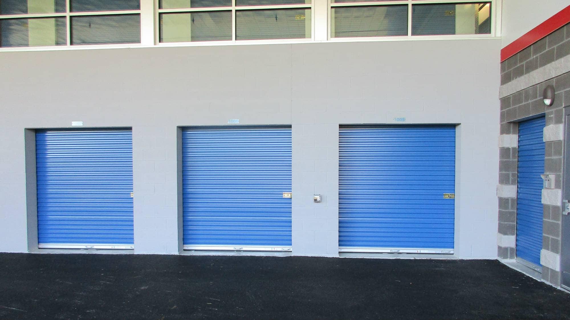 Blue storage doors at Self Storage Plus