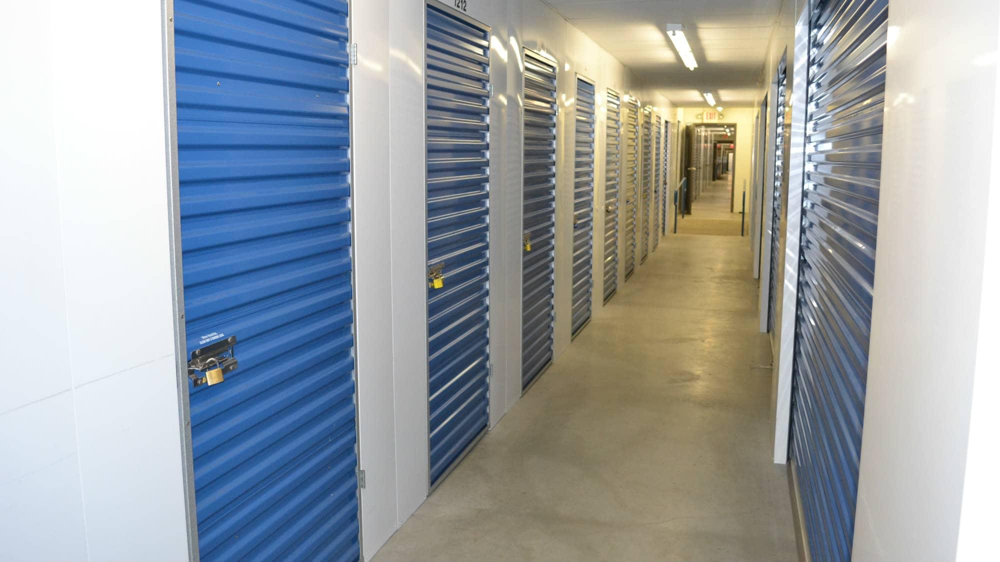 Well-lit hallways at Self Storage Plus in Baltimore, MD