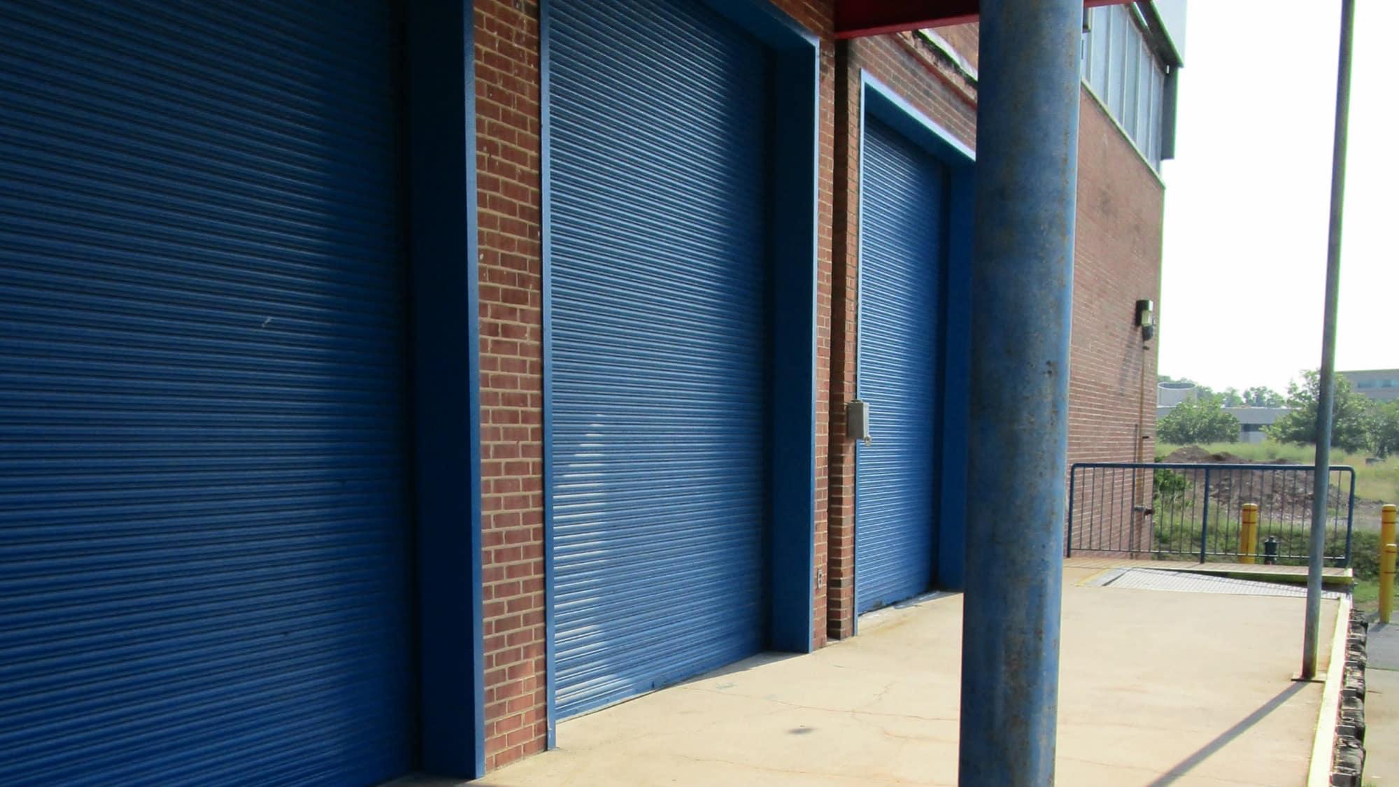 Storage units with blue doors at Self Storage Plus in Lanham, MD