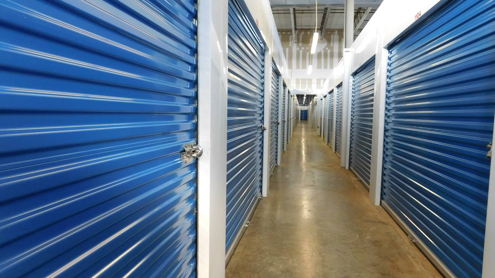 Well-lit hallways at Air and Space Self Storage in Chantilly, VA
