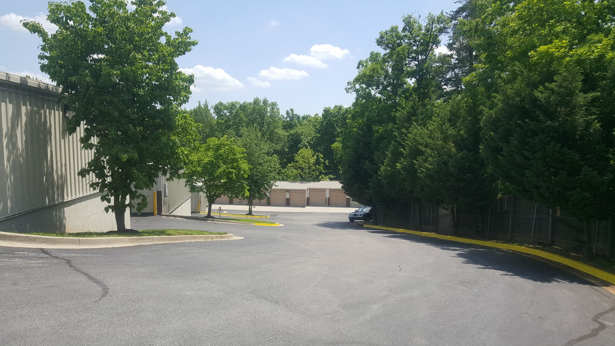 Tree-lined grounds at Seabrook Self Storage in Seabrook, Maryland