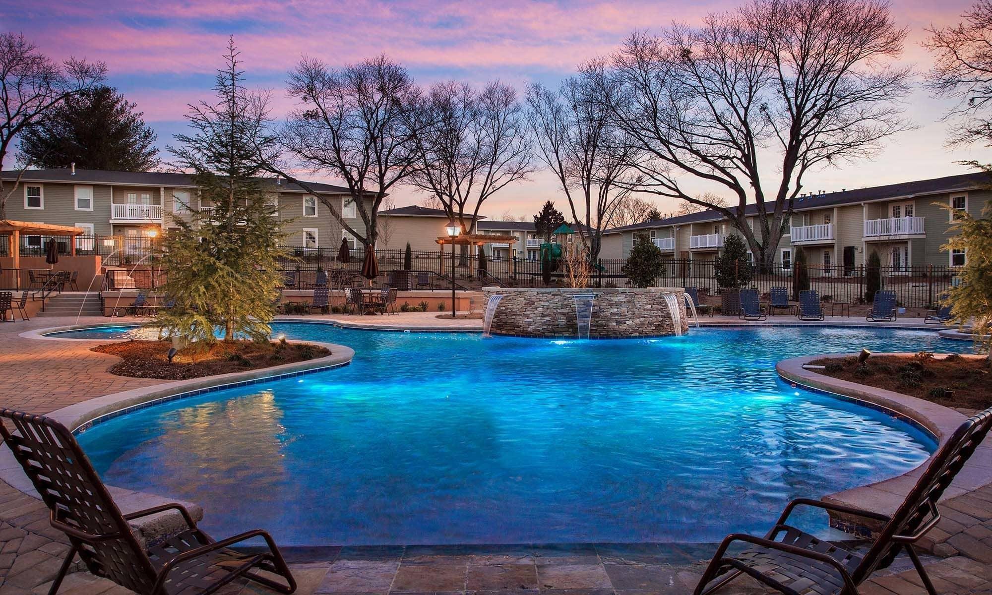 Swimming pool at night at Fern Parc Apartment Homes in Huntsville, AL