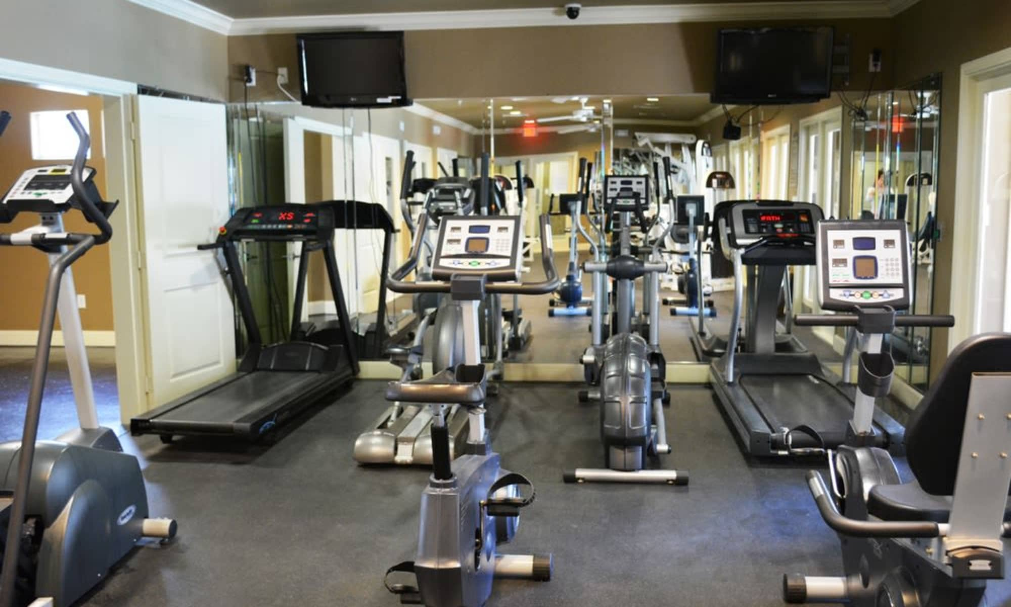 Modern fitness center at The Abbey at Grande Oaks in San Antonio, TX