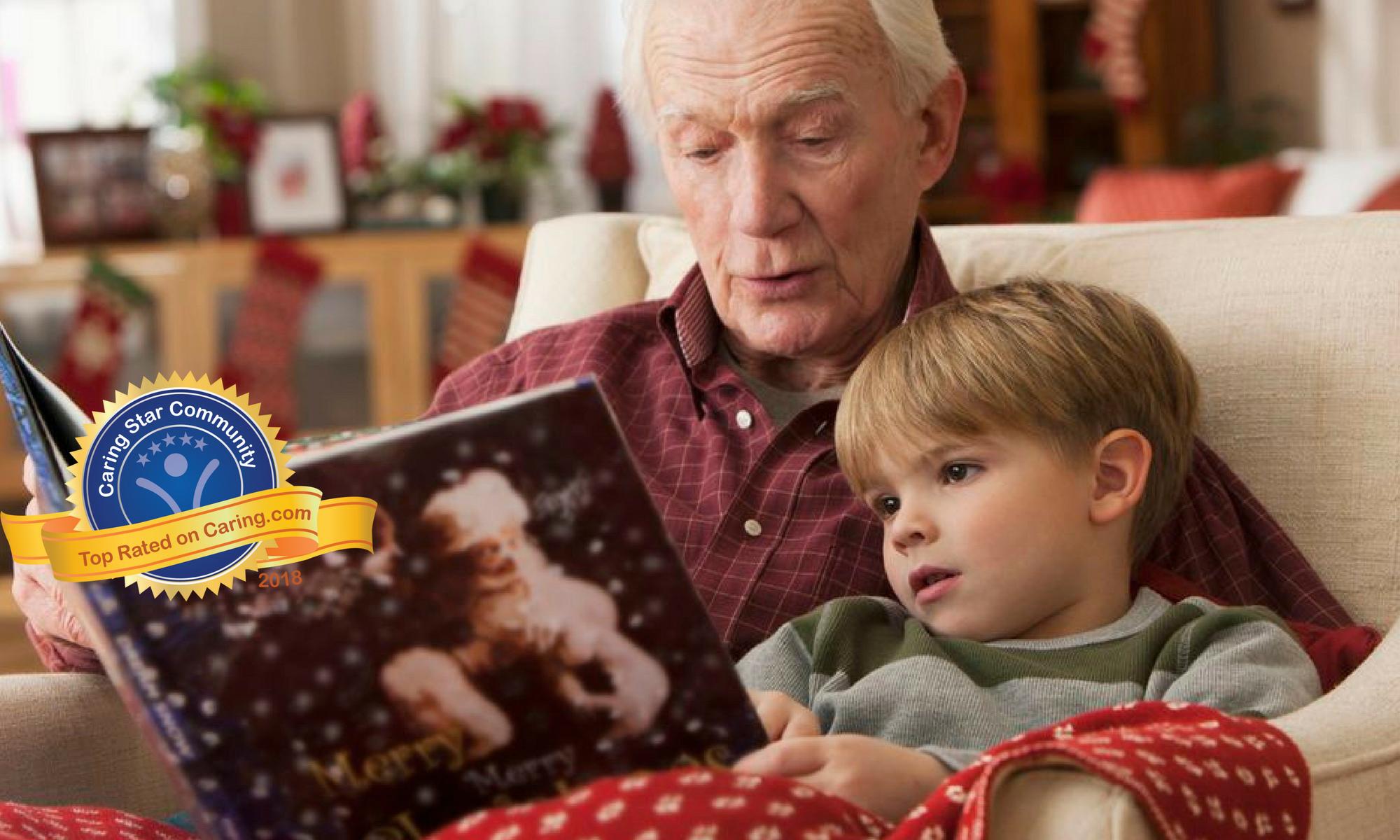 Senior reading a book to his grandson at Meridian at Kessler Park