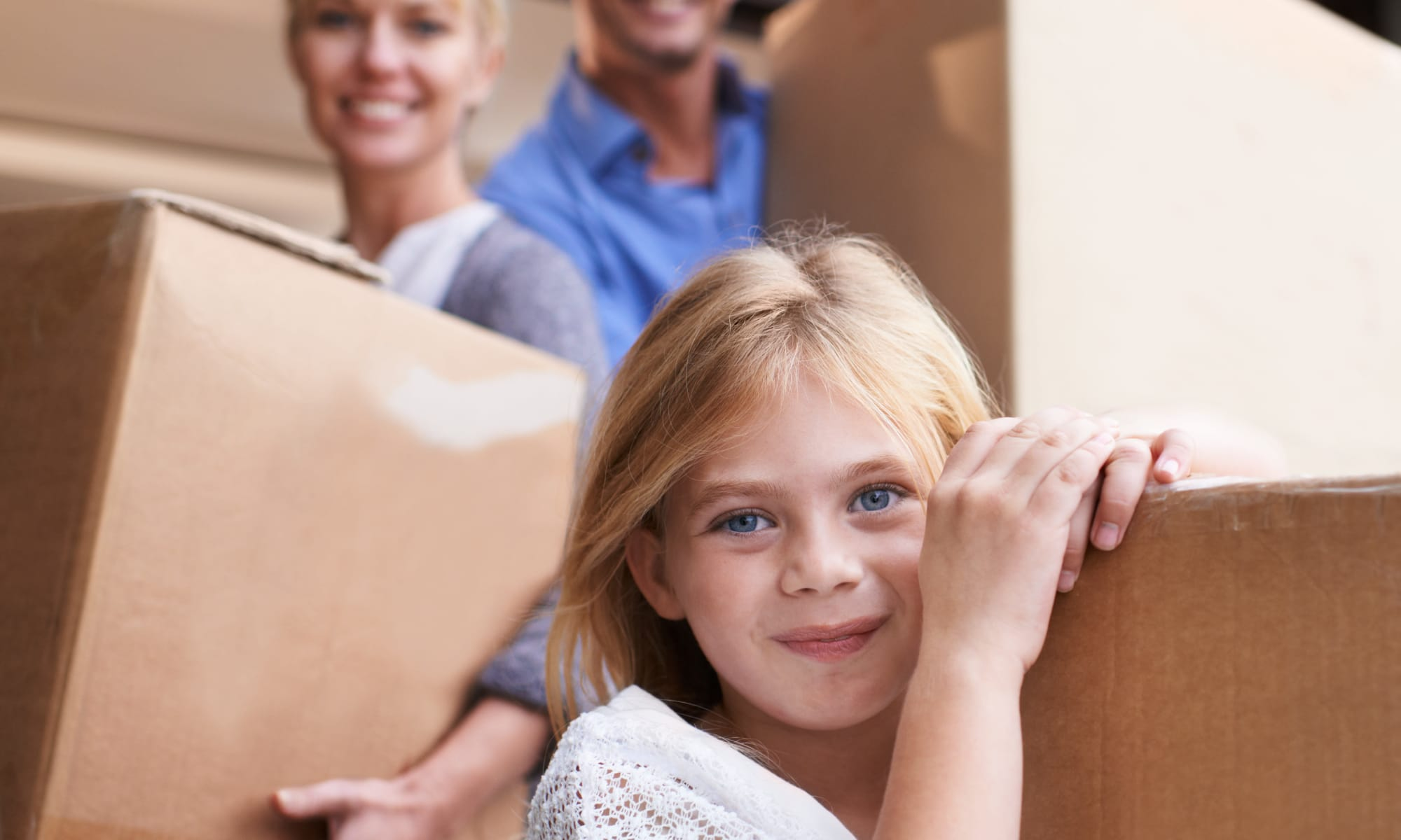 Family helping unload boxes to put in storage units at A Better Self Storage Bott in Colorado Springs Colorado