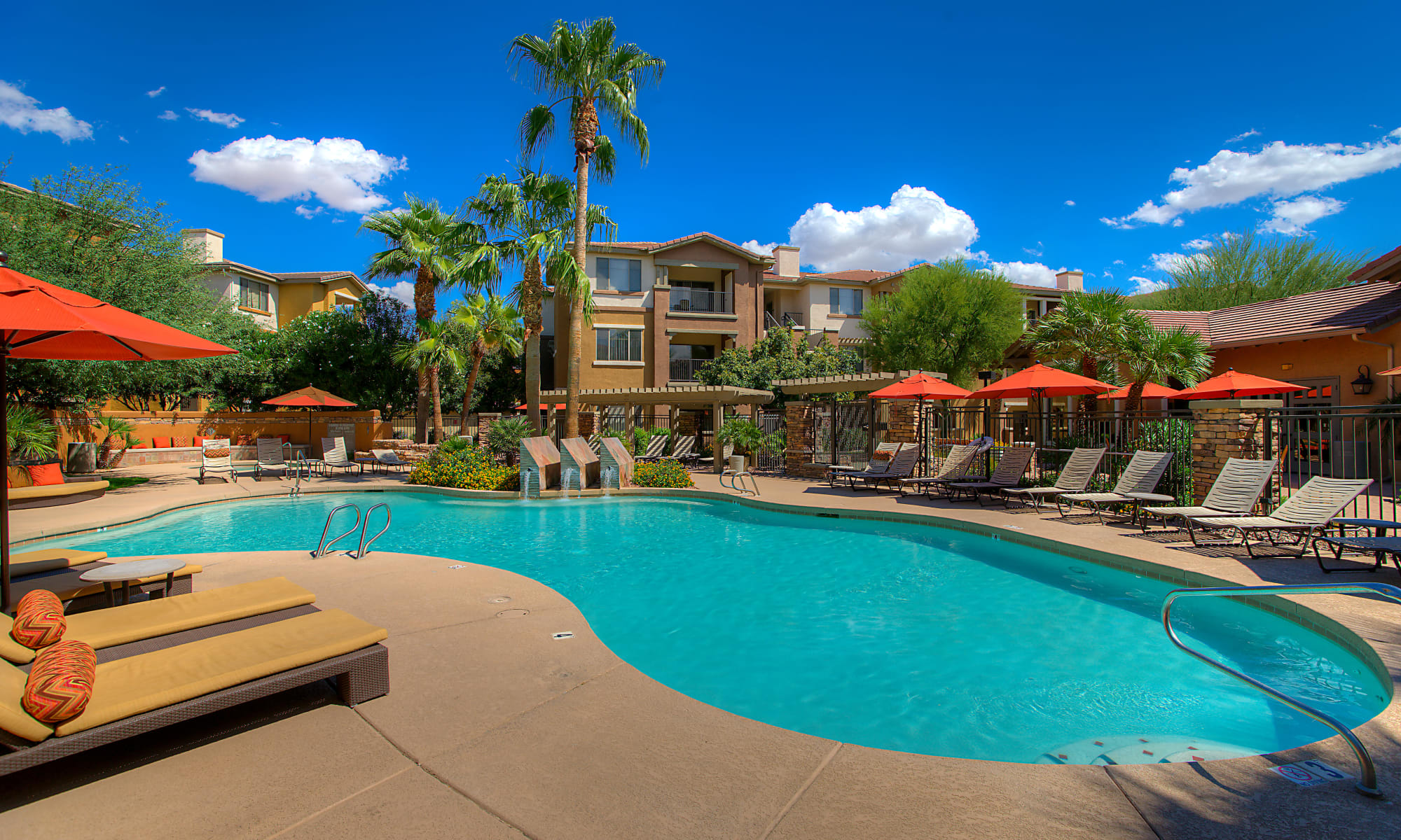 Sit by the pool at Borrego at Spectrum