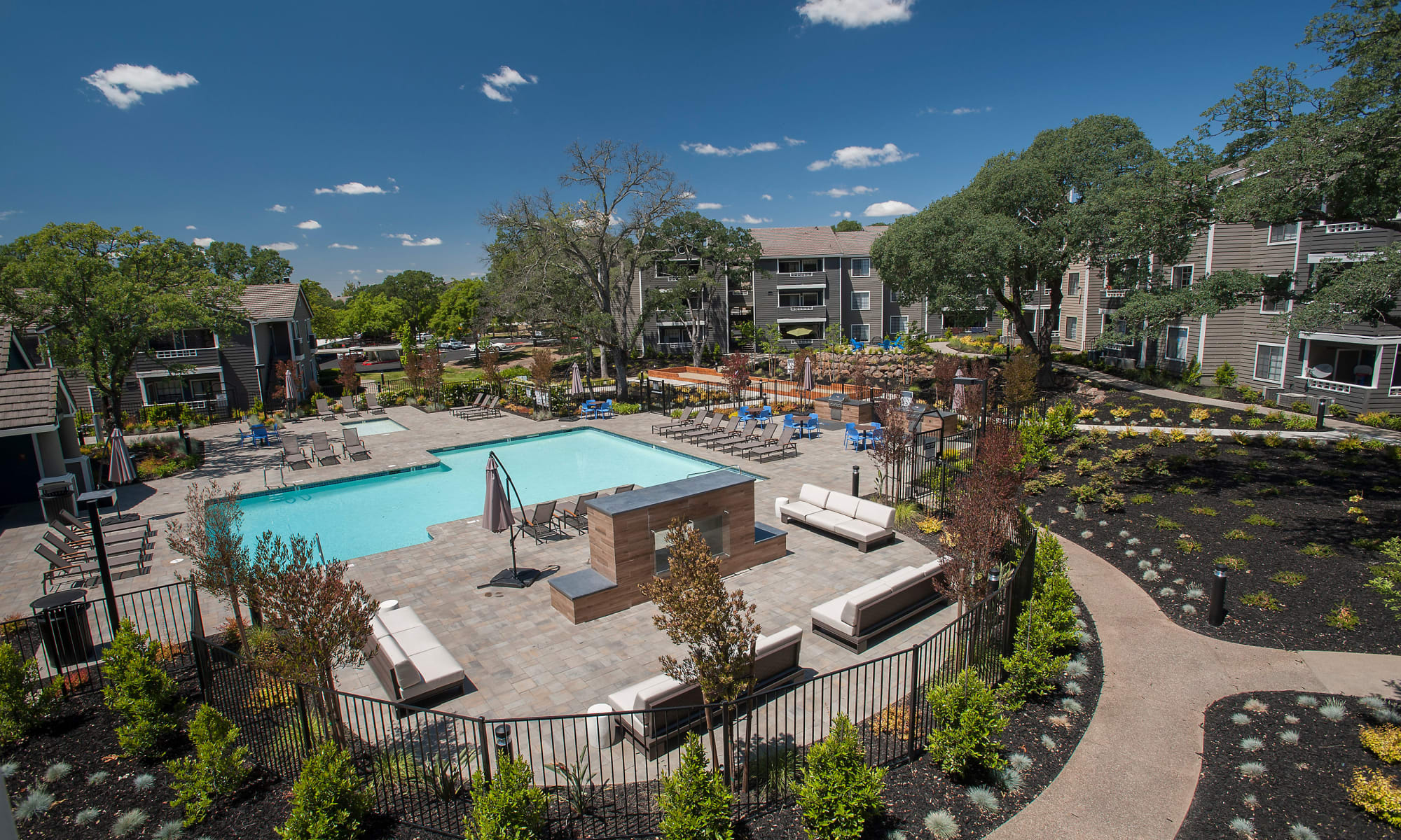 Beautiful landscaping and pool at Slate Creek Apartments in Roseville, California