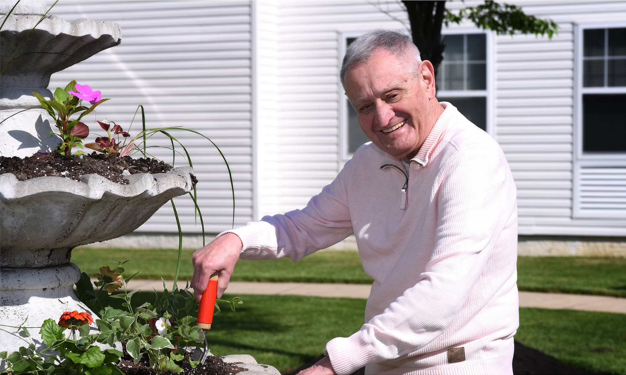 Resident gardening at Mattison Crossing at Manalapan Avenue in Freehold, New Jersey.