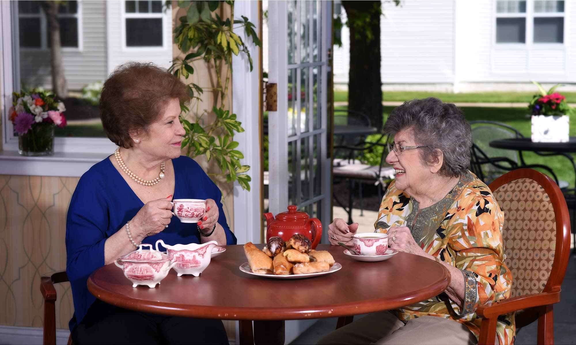 Residents catching up at Mattison Crossing at Manalapan Avenue in Freehold, New Jersey.