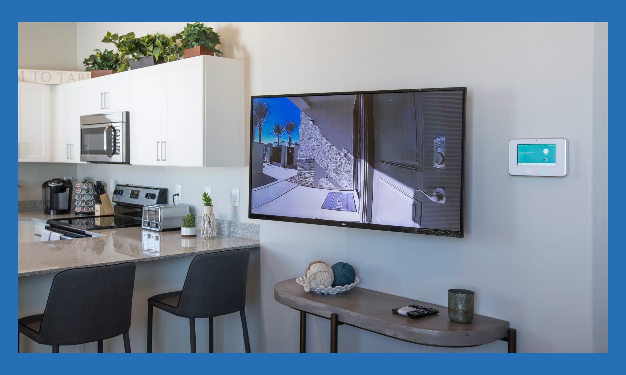 Partial view of the kitchen in the open-concept living space of a model home at Christopher Todd Communities At Marley Park in Surprise, Arizona