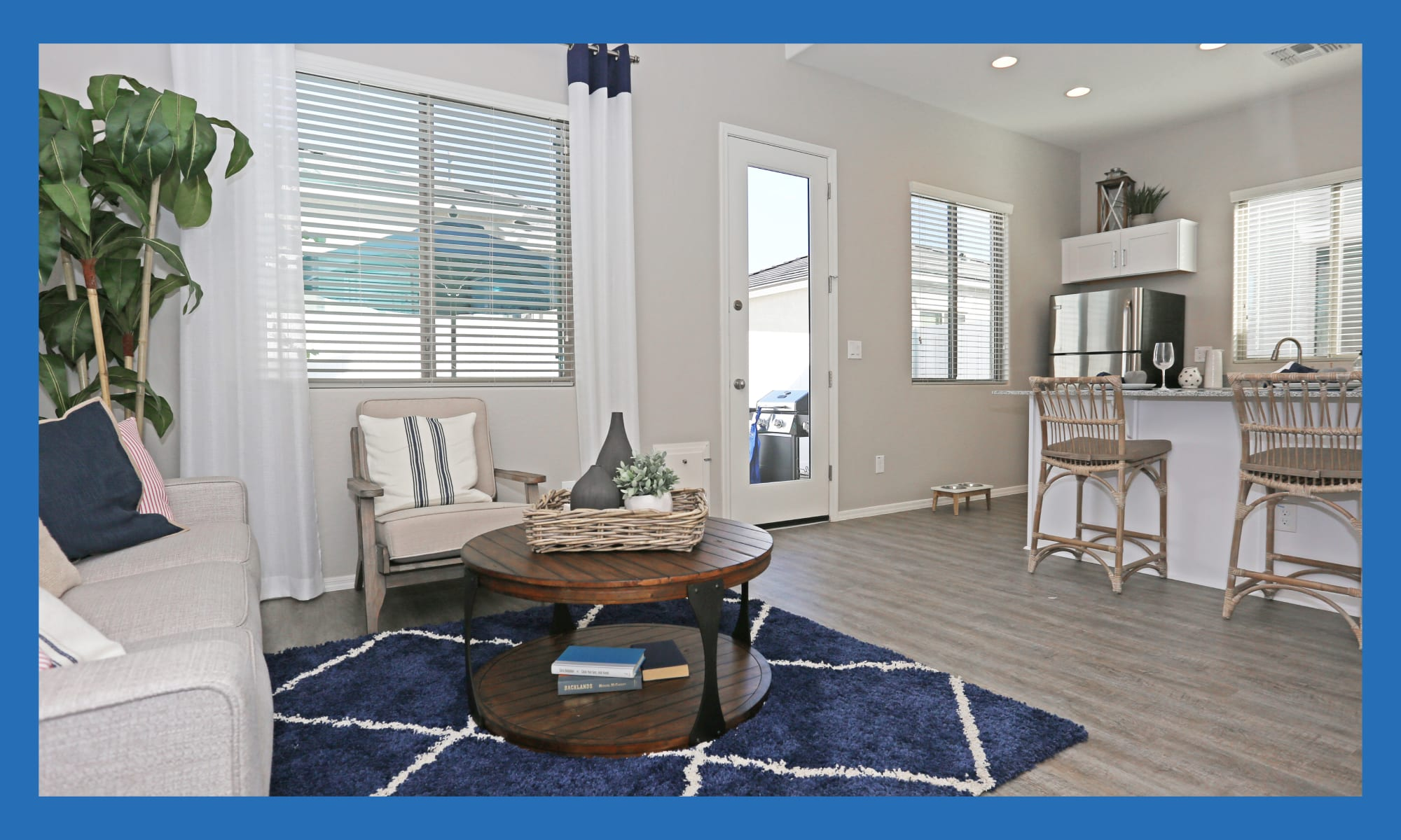 Open-concept layout with hardwood floors in a model home at Christopher Todd Communities At Marley Park in Surprise, Arizona