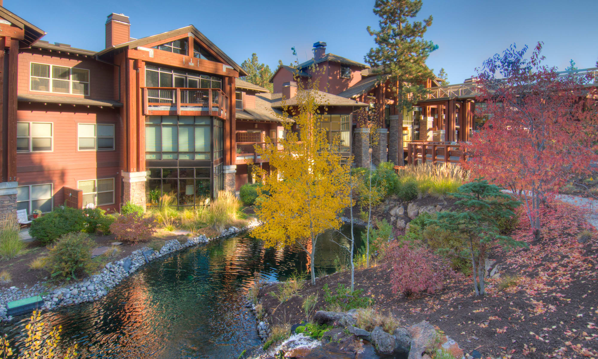The exterior of the river lodge at Touchmark at Mount Bachelor Village in Bend, Oregon