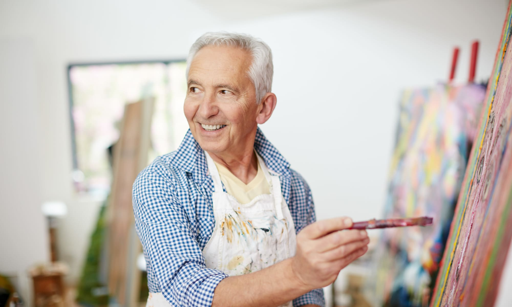 Resident painting at MacArthur Hills in Irving, Texas