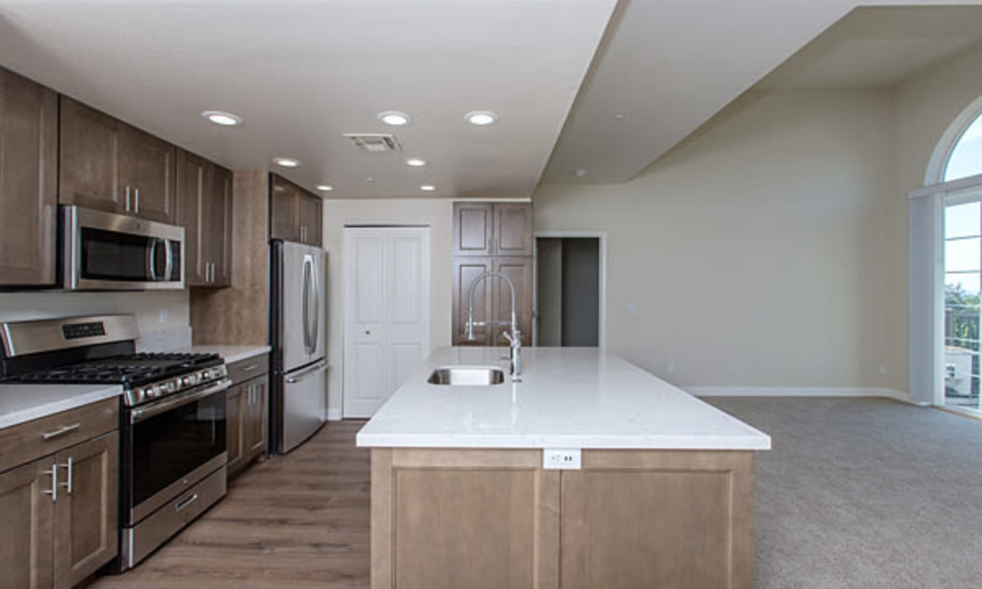 kitchens with granite counter top islands at The Boulders at Fountaingrove