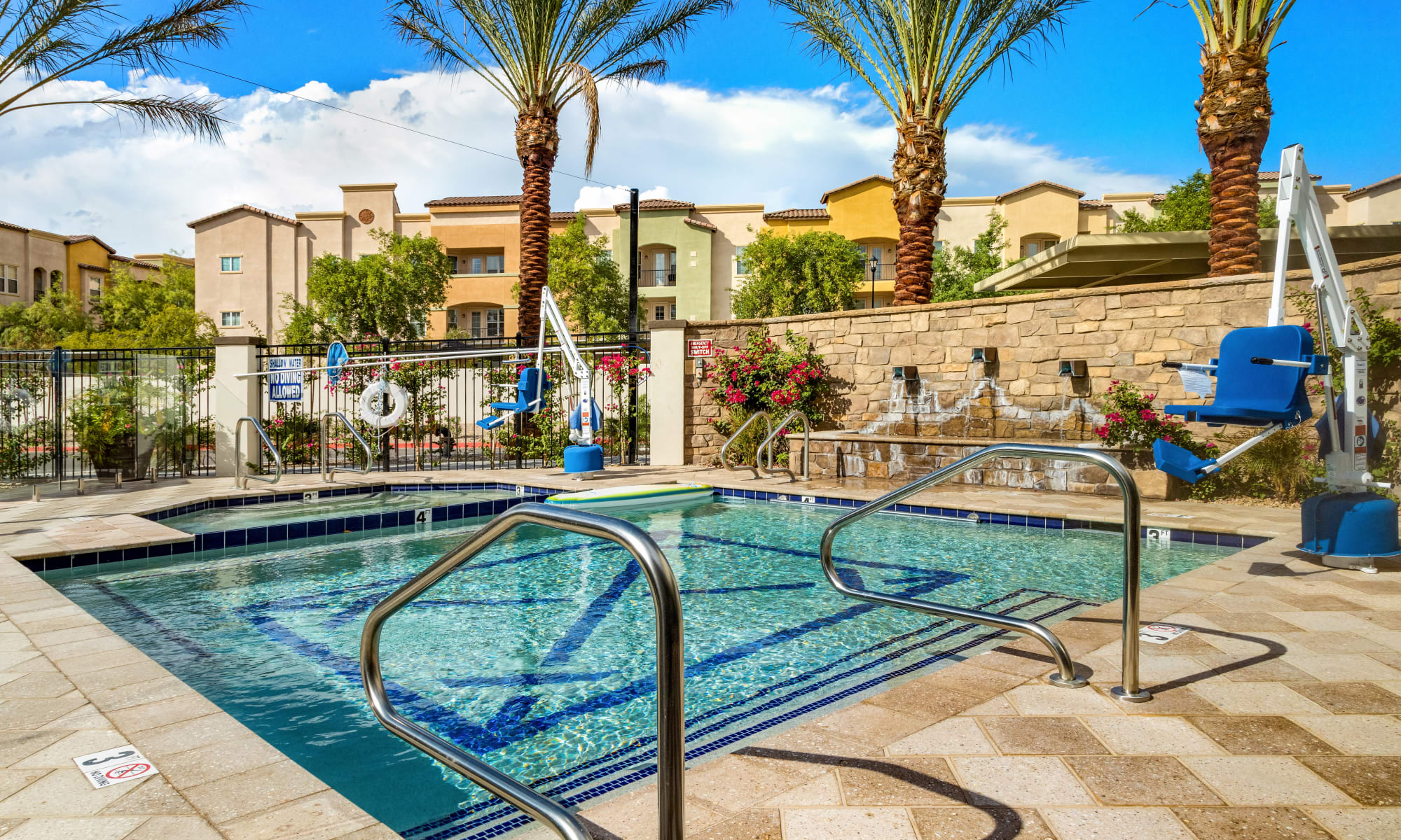 Outdoor patio and pool at The Park at Modesto Independent Living Community
