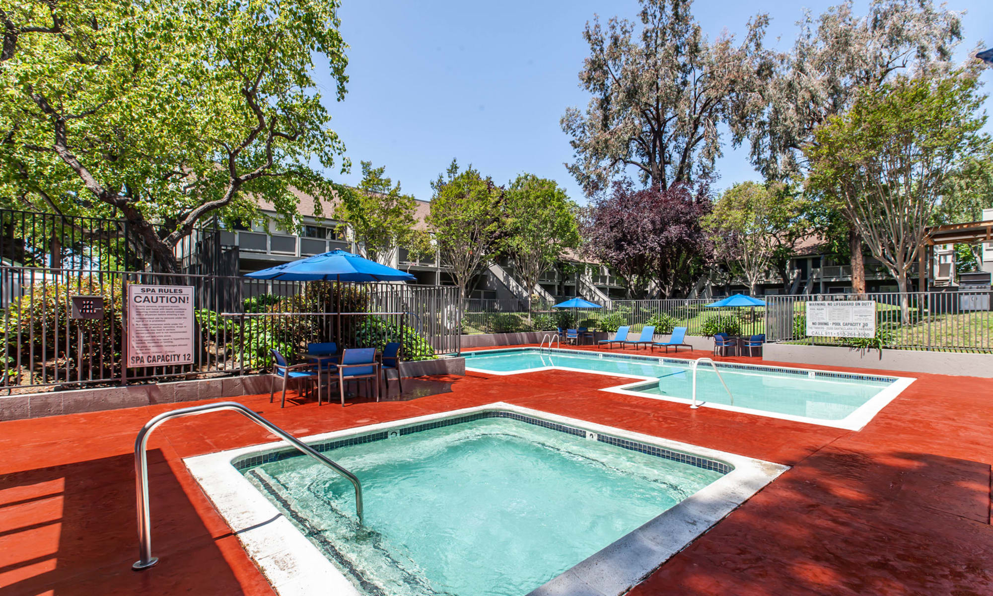 Sparkling pool and large deck and lounge area in Hayward, CA