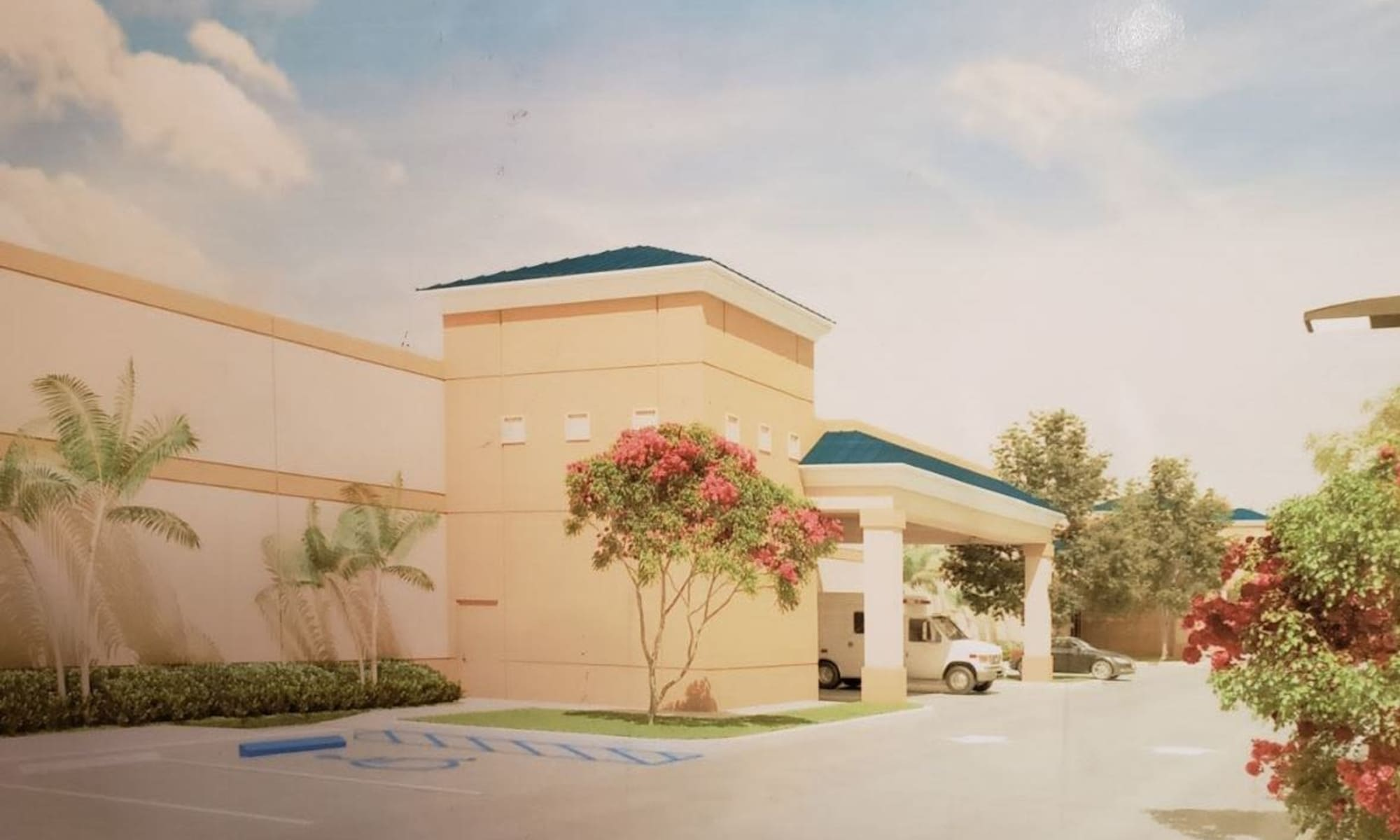 Parking lot and front entry into Top Self Storage in West Palm Beach, Florida