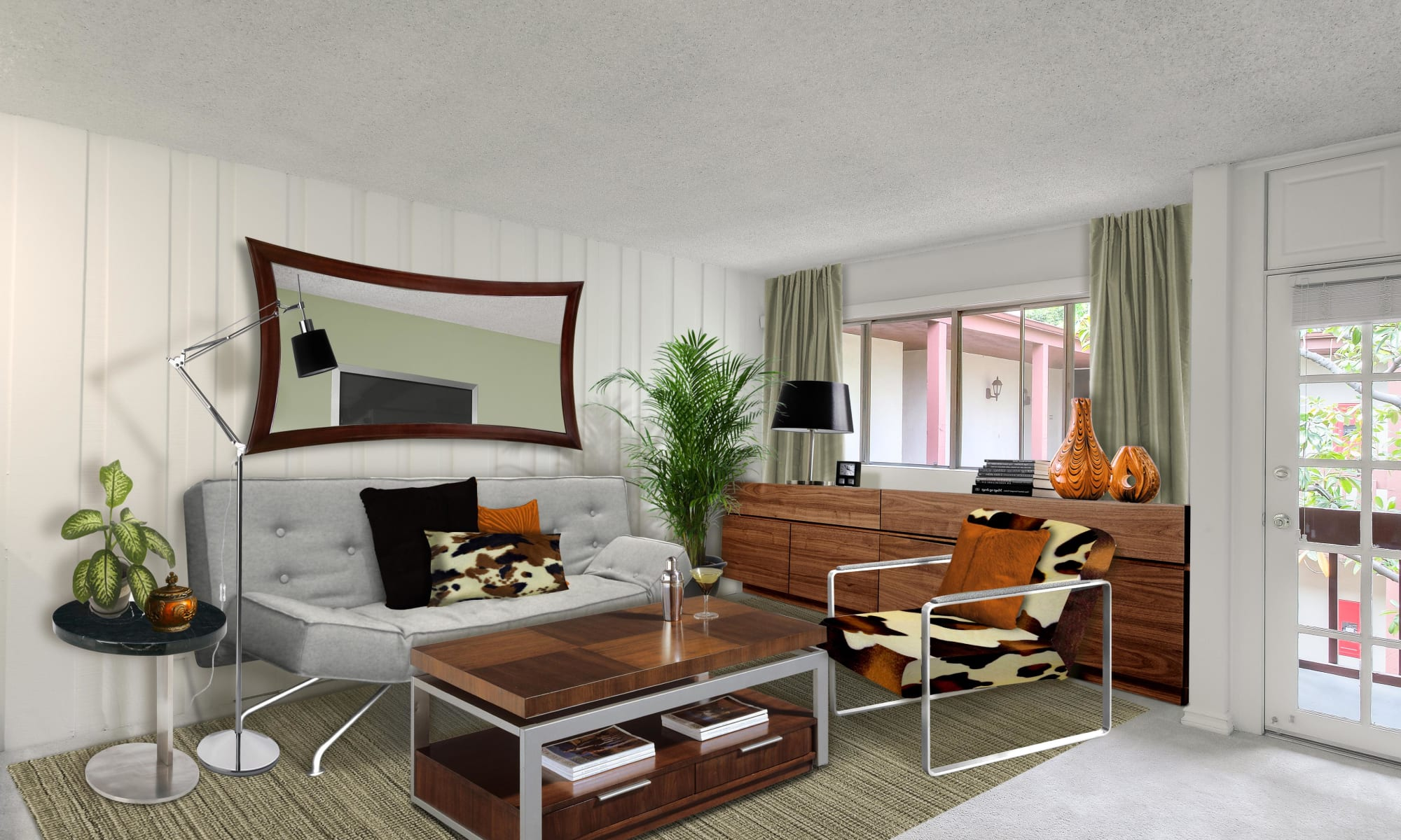 Natural light flooding the well-furnished living area of a model home at Rancho Los Feliz in Los Angeles, California