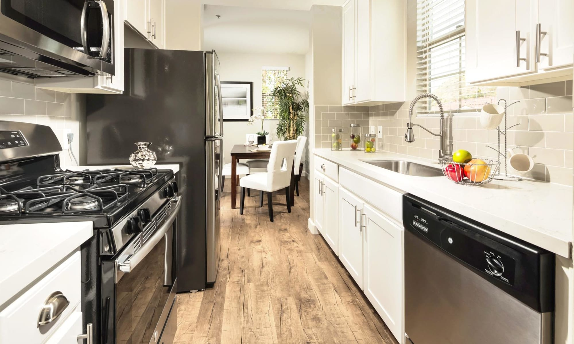 Bright kitchen with stainlesss-steeel appliances at Mission Hills in Camarillo, California