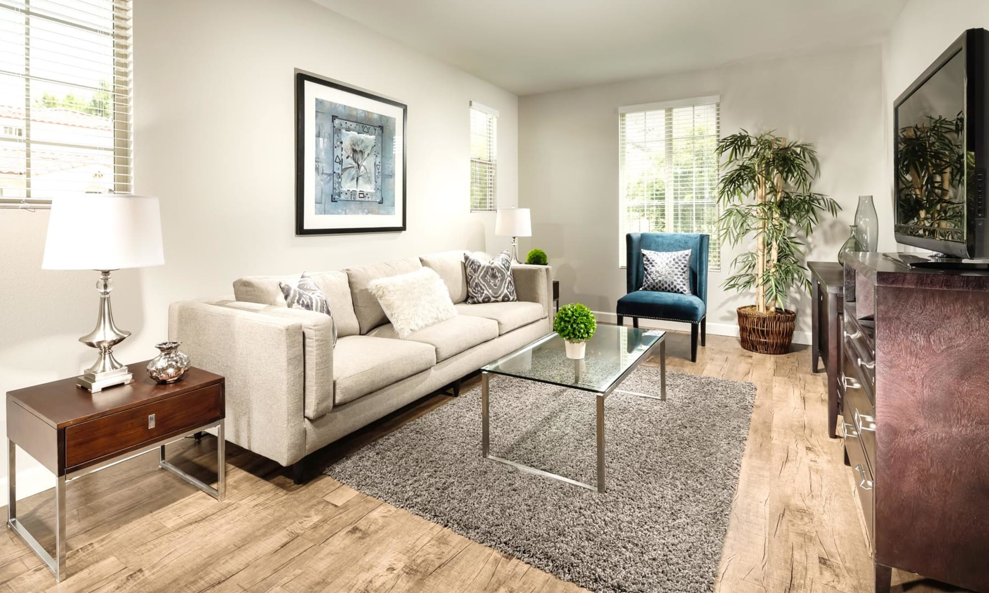 Living room with glass coffee table at Mission Hills in Camarillo, California