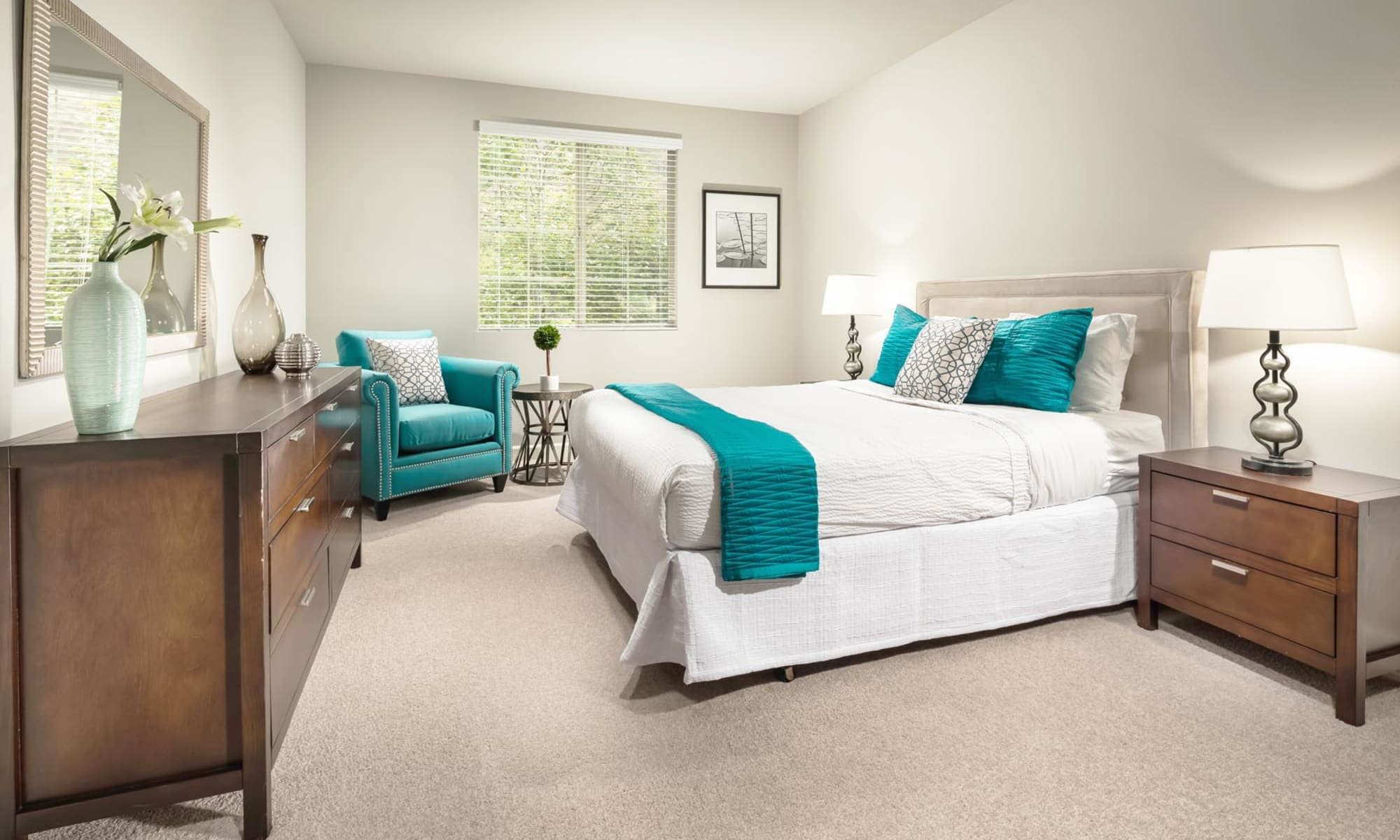 Spacious primary bedroom with plush carpeting in a model home at Mission Hills in Camarillo, California