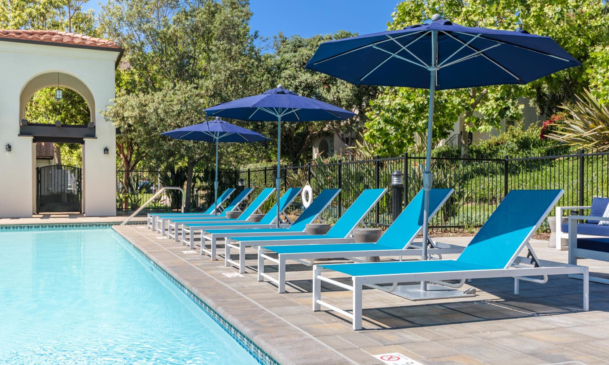 Chaise lounge chairs around the pool at Mission Hills in Camarillo, California