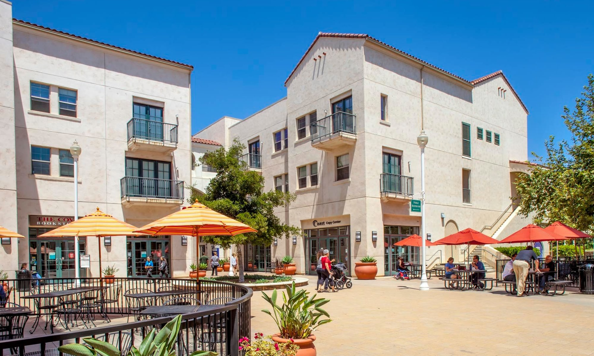 Beautiful courtyard area with shaded seating outside the retail shops and restaurants at Mission Hills in Camarillo, California