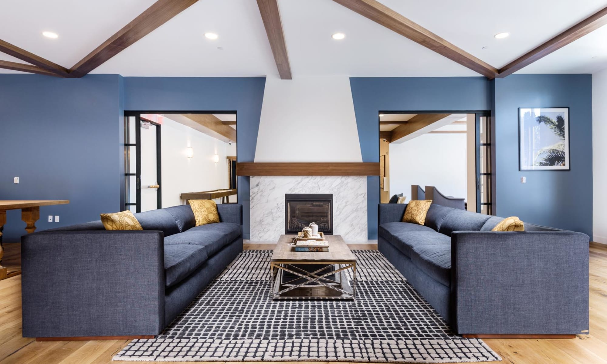 Comfortable couches in front of the fireplace in the clubhouse at Mission Hills in Camarillo, California