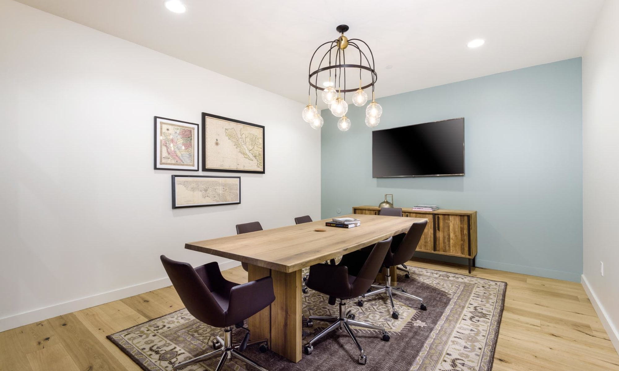 Meeting room with a large conference table and flatscreen TV for resident use in the business center at Mission Hills in Camarillo, California