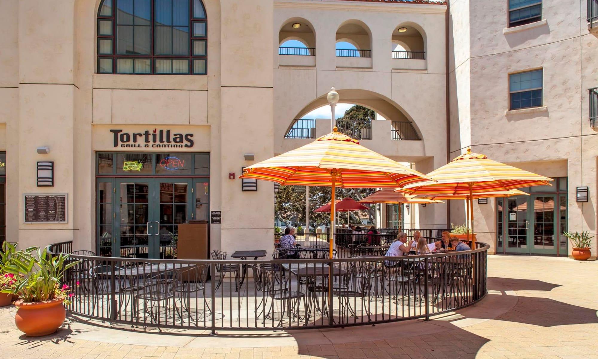 Courtyard with orange umbrellas at Mission Hills in Camarillo, California