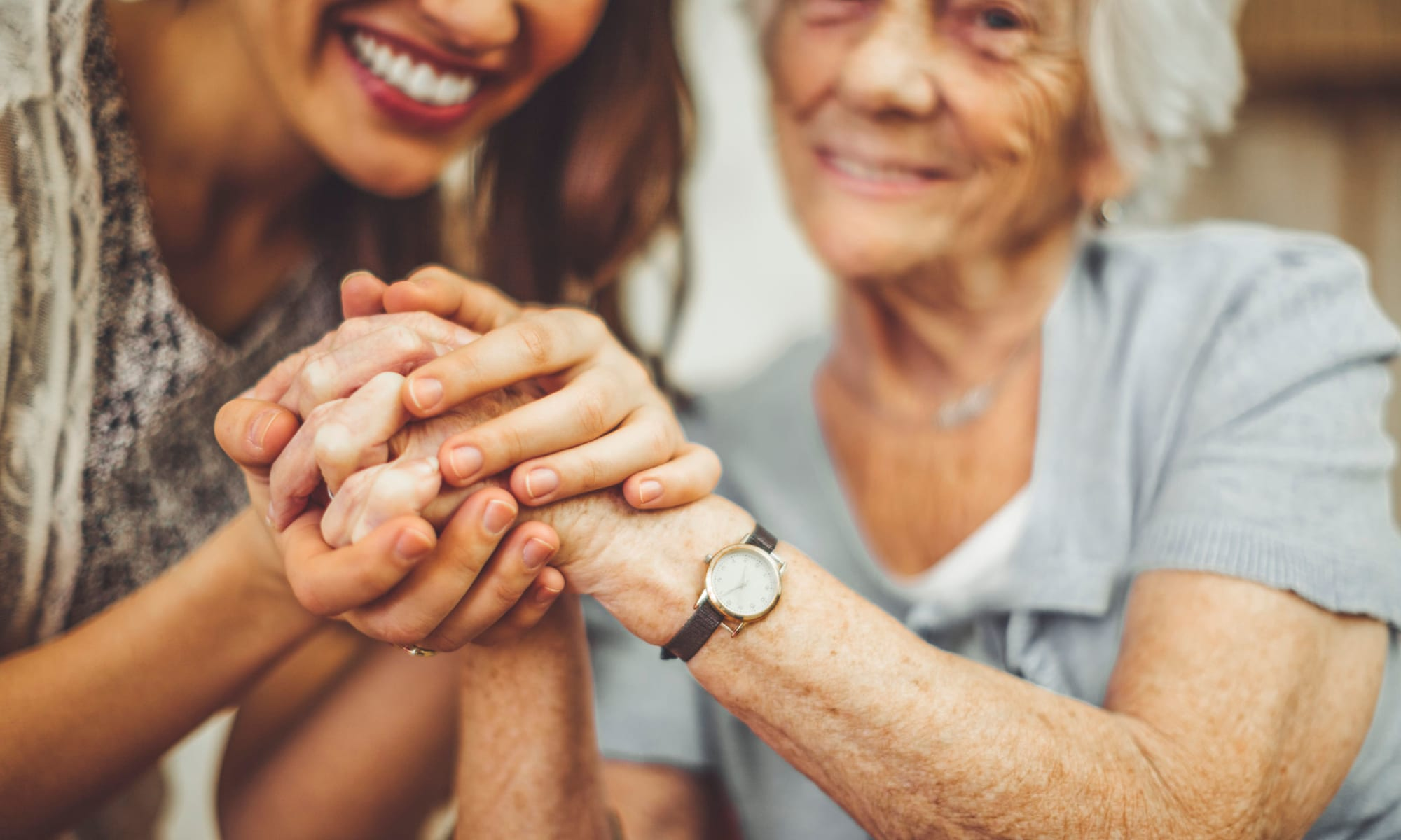 Resident and family member holding hands at Broadwell Senior Living in Plymouth, Minnesota