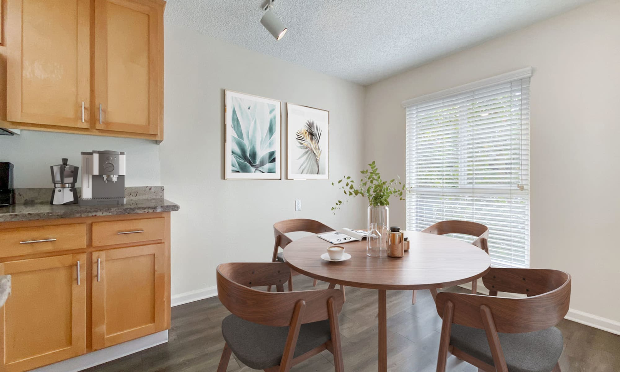 Dining area with a bay window near the kitchen in a model apartment at Pleasanton Glen Apartment Homes in Pleasanton, California