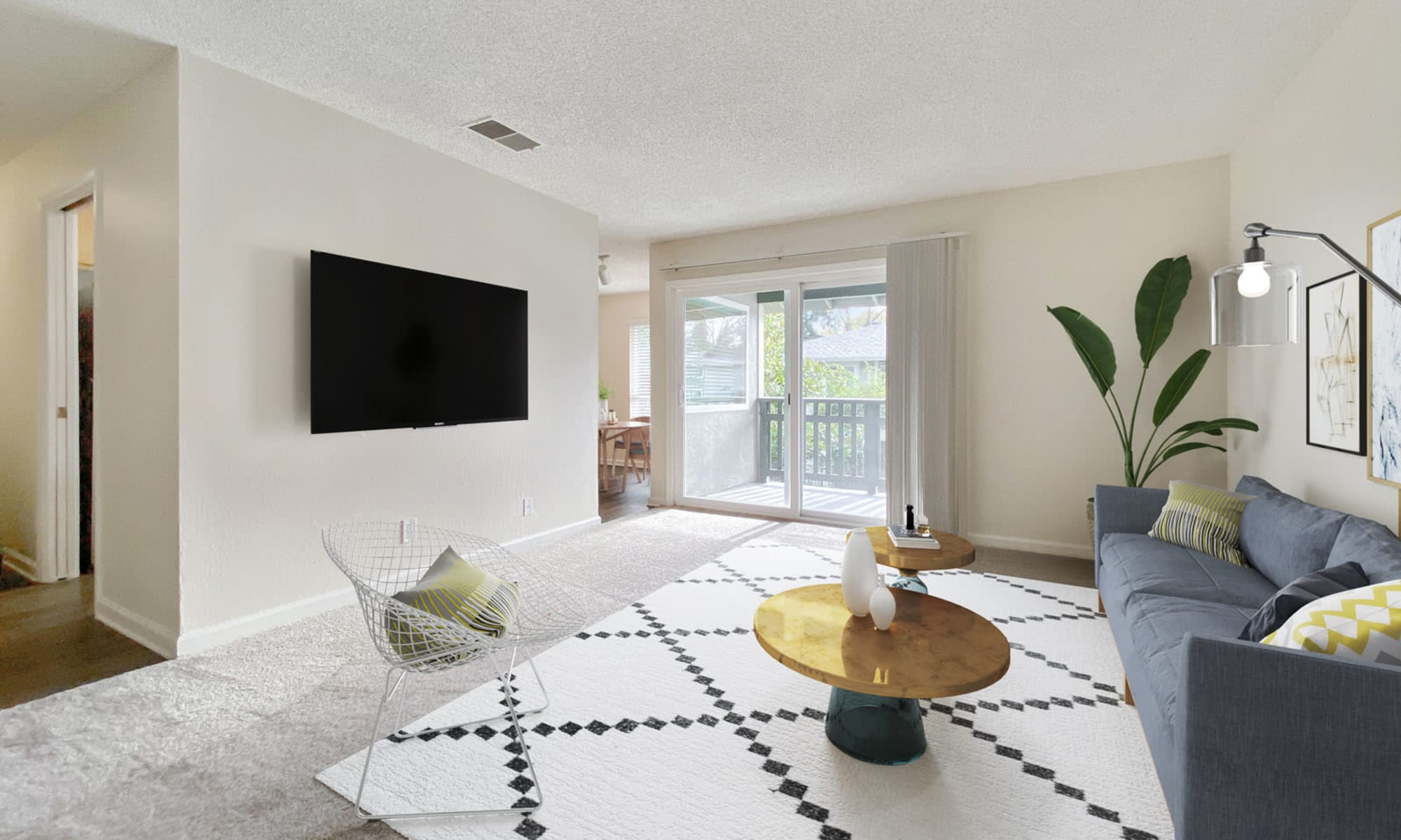 Well-furnished model home's living area at Pleasanton Glen Apartment Homes in Pleasanton, California