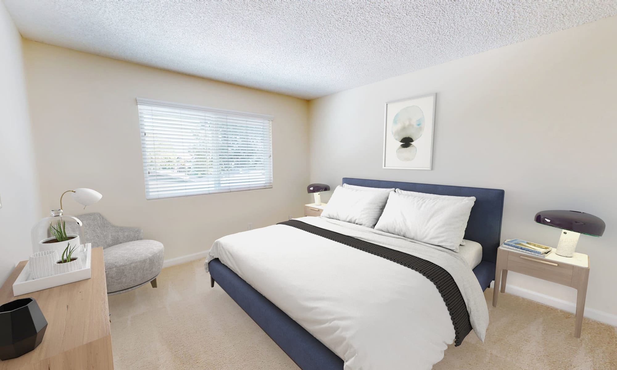 Plush carpeting and a large bay window in a model home's bedroom at Pleasanton Glen Apartment Homes in Pleasanton, California