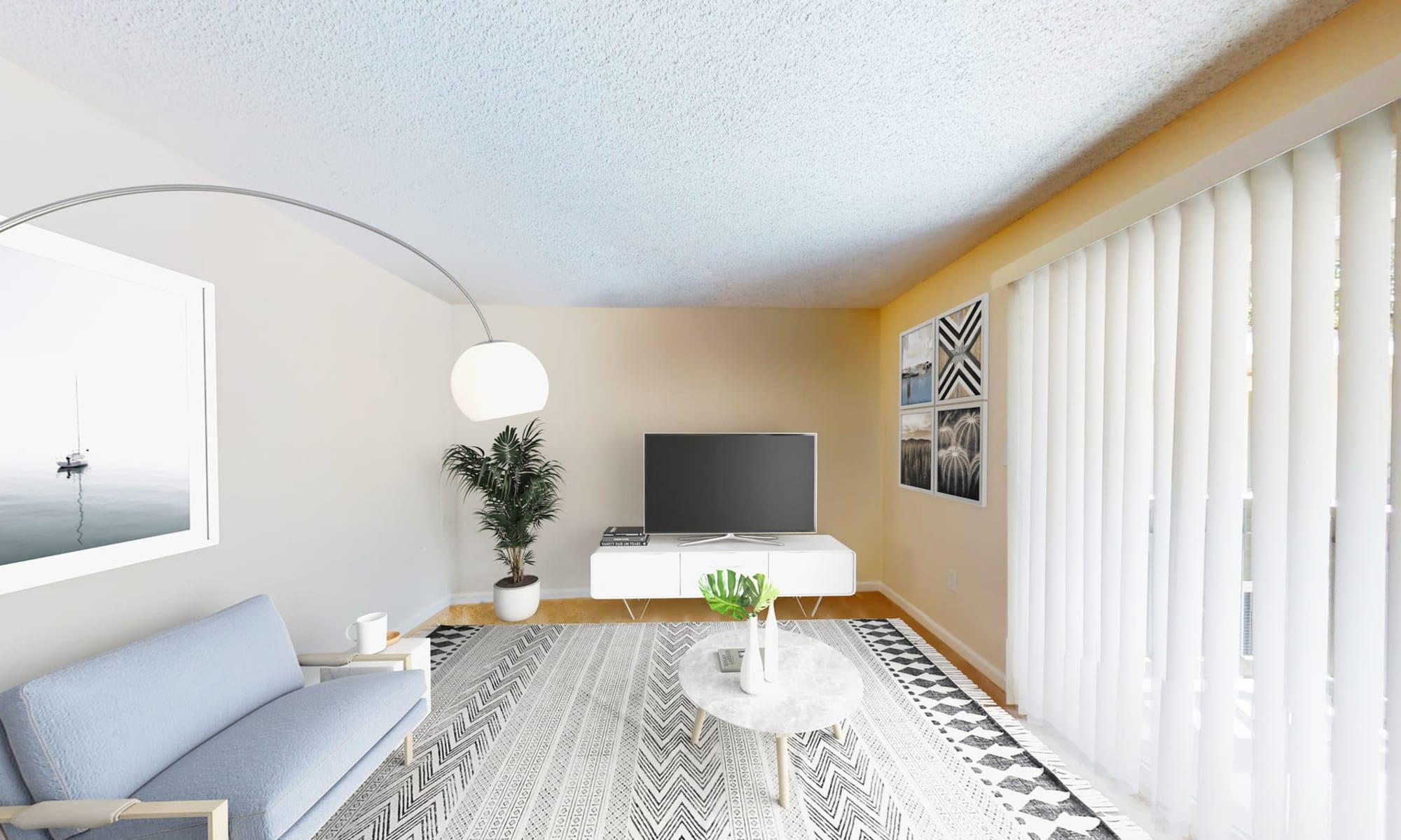 Model apartment's living area with comfortable furnishings at Pleasanton Glen Apartment Homes in Pleasanton, California