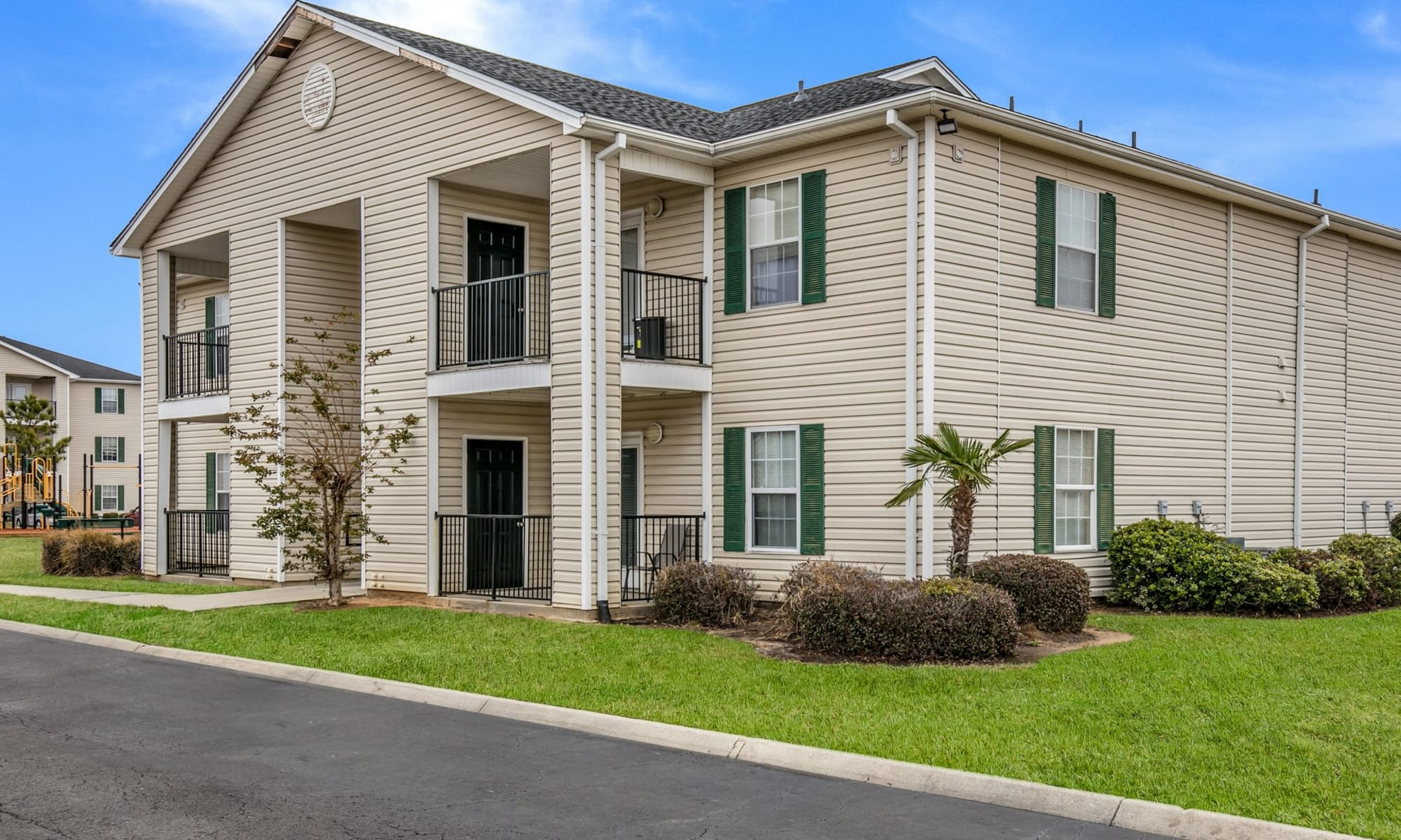 Beautifully landscaped apartments at Bayou Landing Apartments in Gulfport, Mississippi