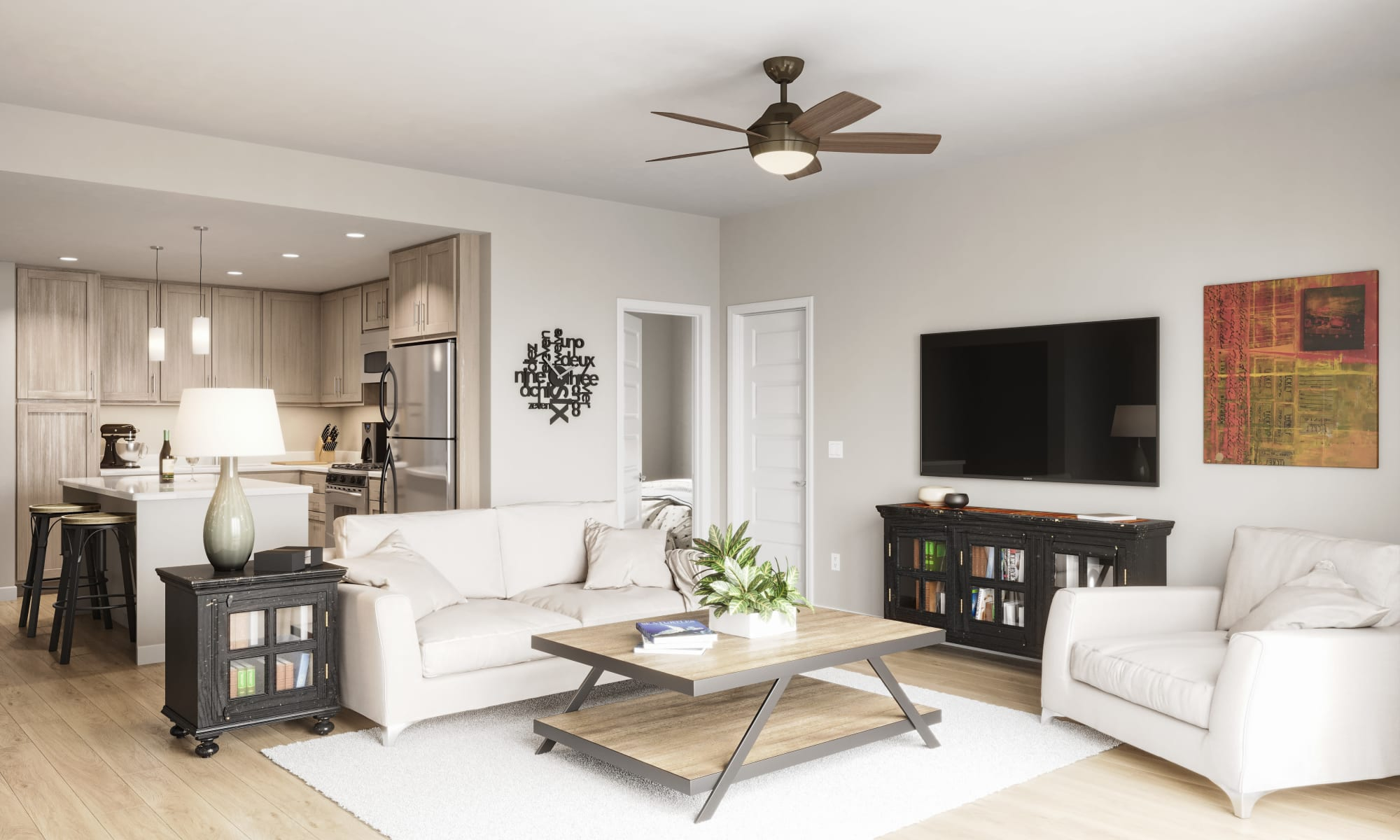 In unit view of the kitchen & living room at Estia Surprise Farms in Surprise, Arizona