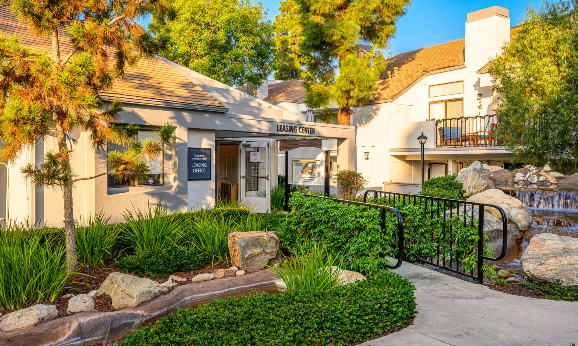 Professionally landscaped grounds outside the leasing office and throughout the community at Sendero Huntington Beach in Huntington Beach, California