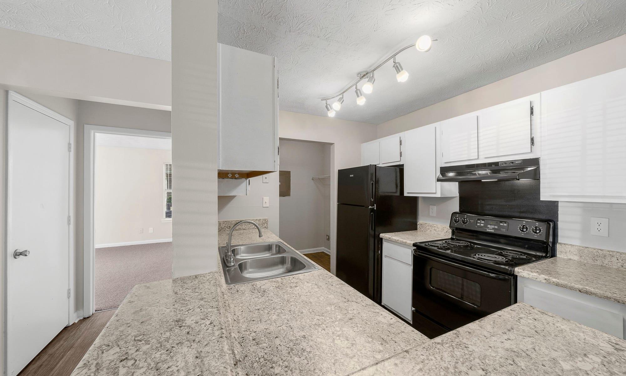 A bright, clean kitchen at The Greens at Cascade Apartment Homes in Atlanta,GA