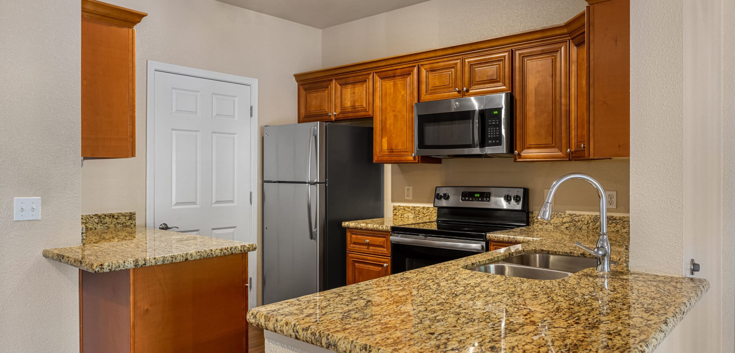 Modern kitchen with granite style counters at Azure Creek in Cave Creek, Arizona