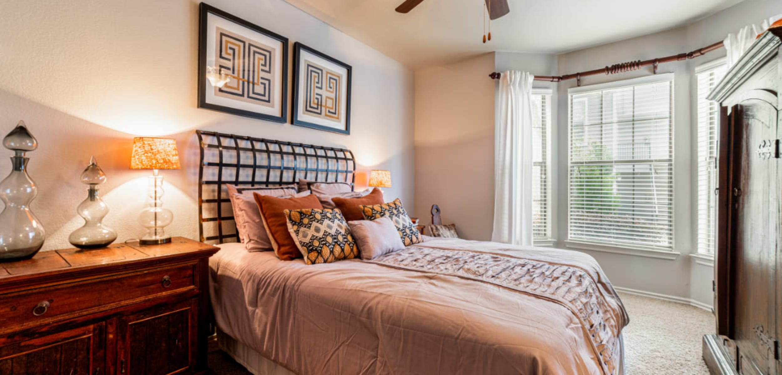 Bedroom with a large window at Marquis at Lantana in Flower Mound, Texas