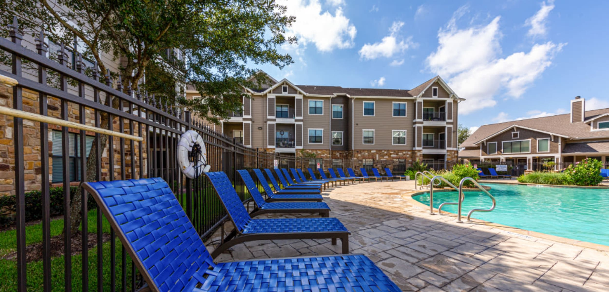 Pool deck and lounge area at Marquis at Katy in Katy Texas,
