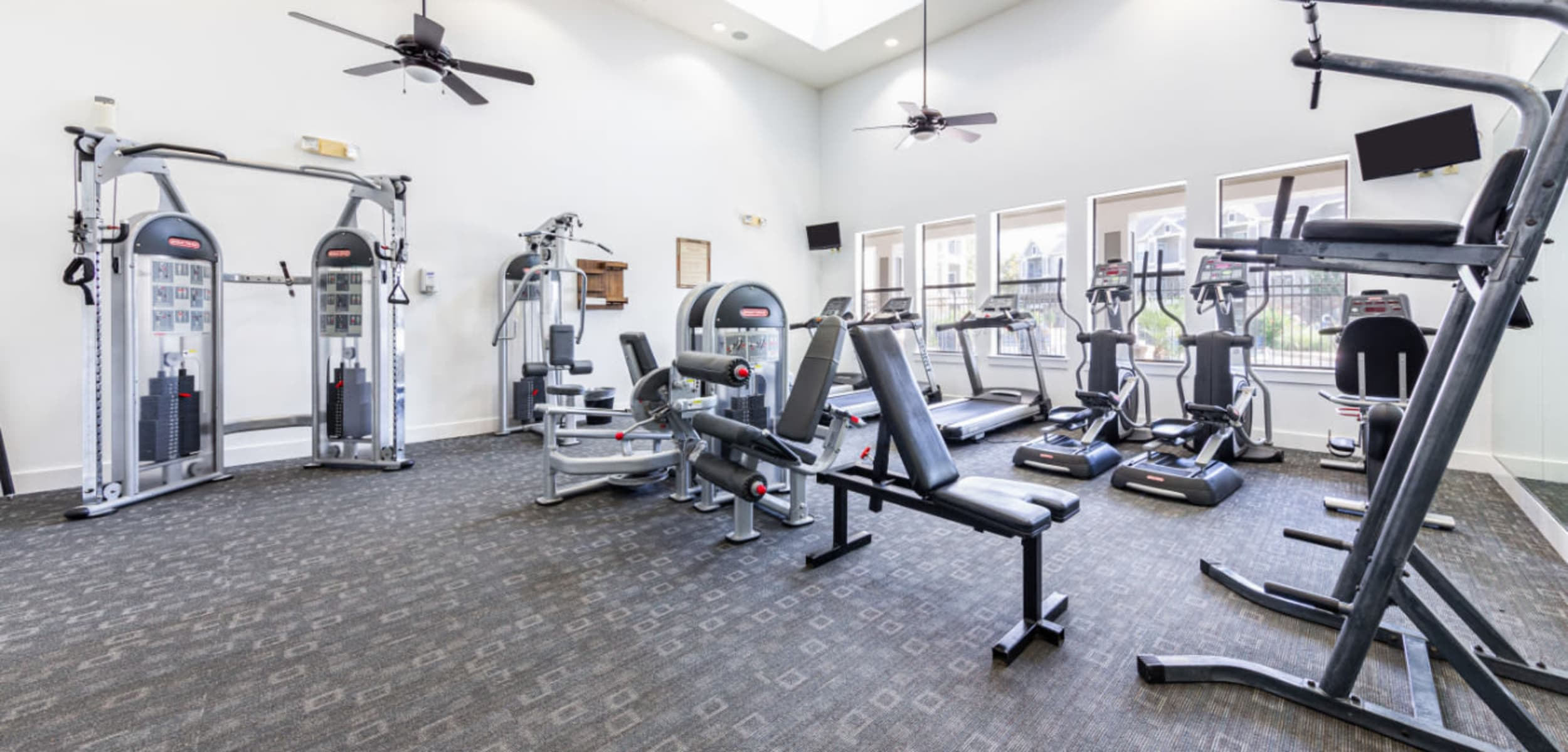 Well-equipped gym at Marquis at Katy in Katy, Texas