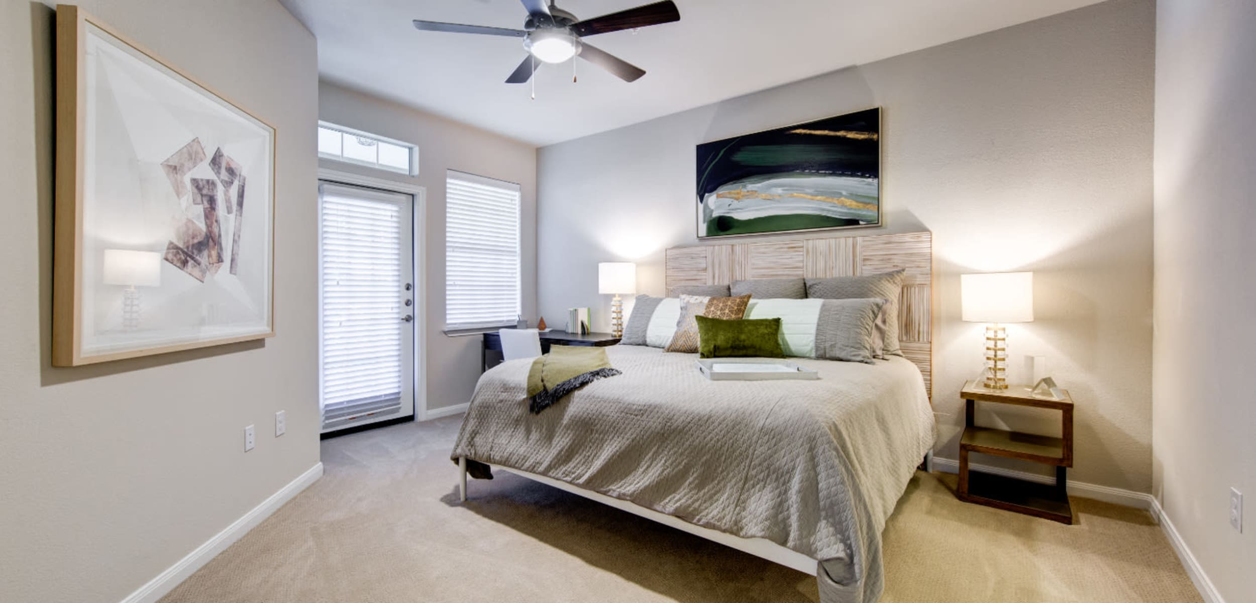 Spacious bedroom with private patio at Marquis at Cinco Ranch in Katy, Texas
